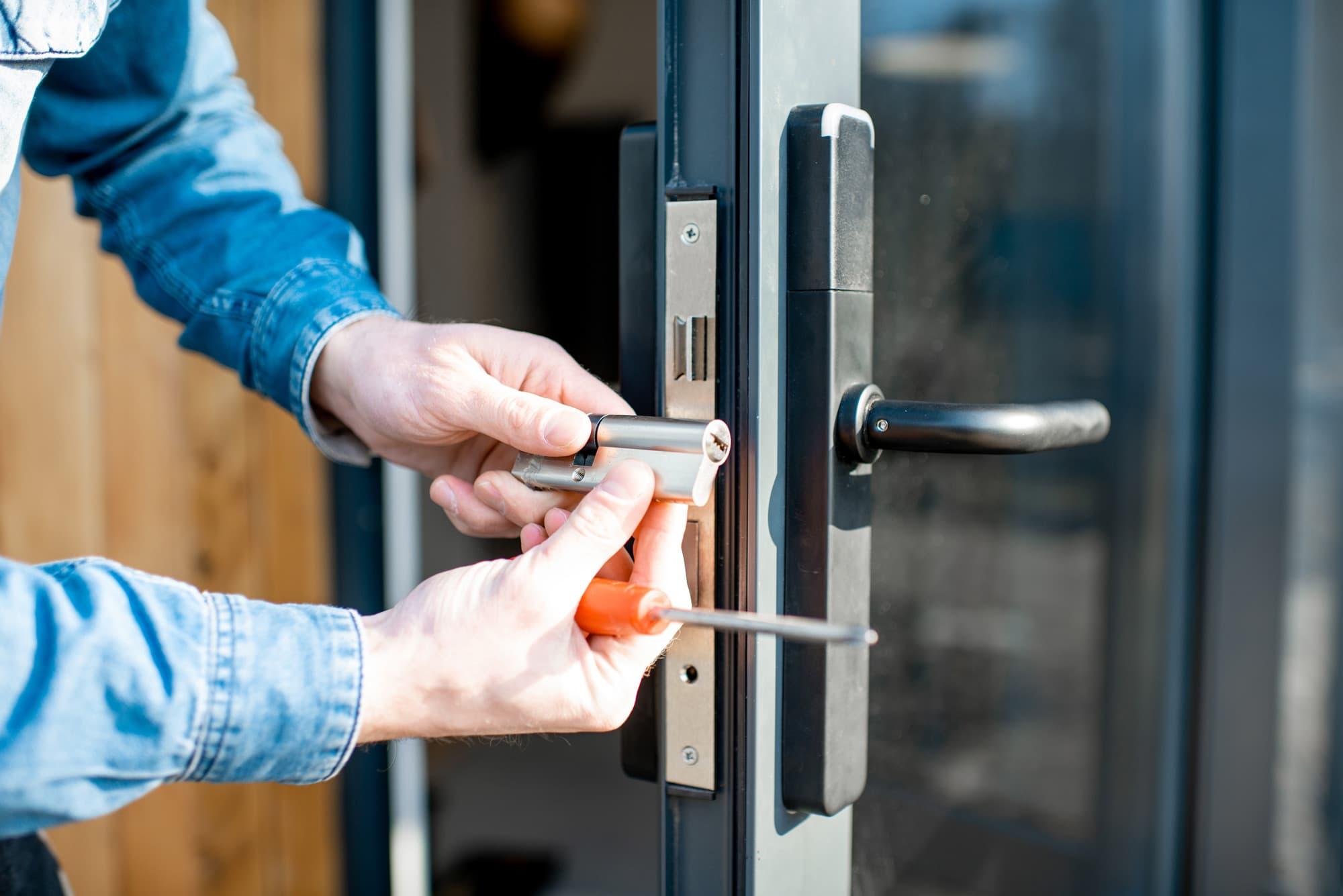 man-changing-core-door-lock-entrance